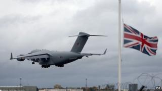 The RAF plane carrying the coffin of L/Cpl James Brynin lands at RAF Brize Norton