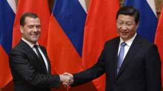 Analysts say Mr Medvedev's (left) meeting with Mr Xi has further strengthened ties