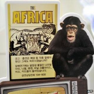 A 'This Africa' cigarette ad with a monkey