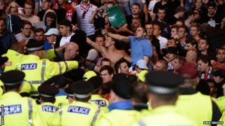 Police intervene as Ajax fans