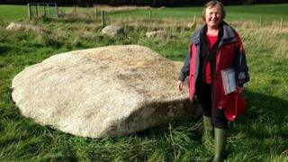 Pip Richards from the Sustainable Trust with the quoit's capstone
