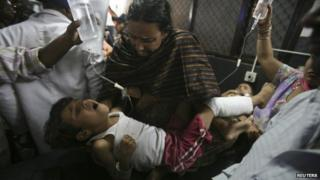 Indian villagers, injured in what witnesses said was firing from the Pakistan side of the border, are taken to a hospital in Jammu October 24, 2013