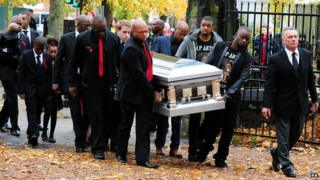 The coffin bearing Antoin Akpom is carried into St Peter's Church