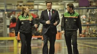 Cameron with apprentices at BMW Mini plant