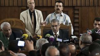 Chief Judge Qarmuty before journalists