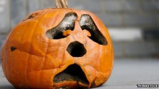 A pumpkin carved with a sad face