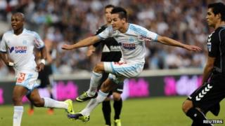Olympique Marseille's Florian Thauvin shoots and scores against Reims during their French Ligue 1 soccer match at the Velodrome stadium in Marseille on 26 October 2013