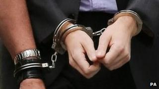 Handcuffs on suspect in UK - file pic