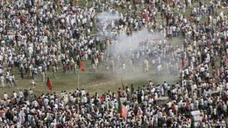Smoke rises after a bomb exploded near a public ground where Narendra Modi was to address a rally in Patna October 27