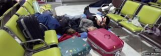 Passengers sleeping on the ground at Charles de Gaulle Airport in December 2009 when snow caused cancellations and delays