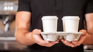 Barista with coffee tray