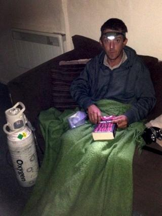 David Williams sits at home with head-torch