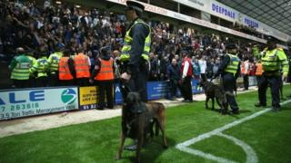 Police and police dogs at a football match