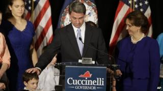 Ken Cuccinelli with his family as he makes a speech following his defeat