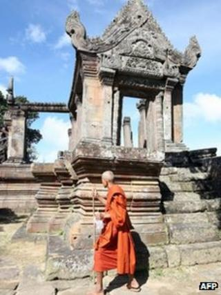 A Cambodian Buddhist monk walking at the Preah Vihear temple, some 543 kilometers north of Phnom Penh, along the border with Thailand, This file photo taken on November 7, 2008
