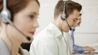 Call centre callers at work (staged)