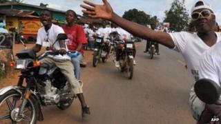 People on motorbikes in Monrovia, Liberia