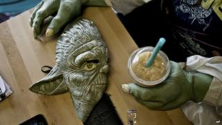 Yoda mask on a table in coffee shop