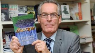 Gerry Kelly with book The Escape