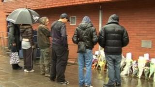 Family hold vigil outside police station