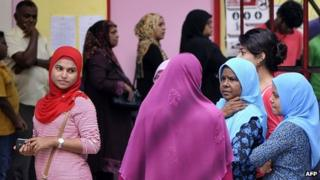 Maldivian voters line up at a local polling station in Male