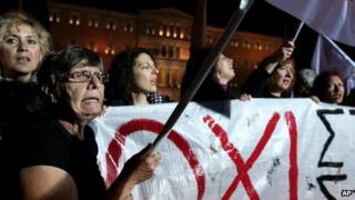 Rally outside Greek parliament in Athens, 10 November 2013