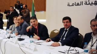 Members of the Syrian National coalition (SNC) attend a meeting of the National Coalition on November 9, 2013, in Istanbul