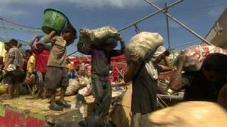 People carrying bags of rice