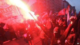 People hold burning flares during a march in Warsaw. Photo: 11 November 2013