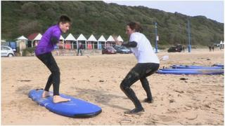 Brandon and Zoe perfecting surfing skills