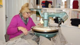 Woman making a Guernsey jumper