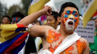 Tibetan activists hold a demonstration on 22 October 2013 outside the UN in Geneva.