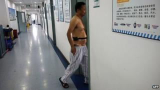 A man with diabetes walks into a ward at a diabetes hospital in Beijing (September 2013)