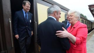 US Captain Tom Watson and European Captain Paul McGinley are greeted by the Provost for Perth and Kinross Liz Grant at Gleneagles train station