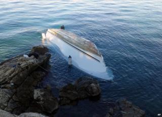 The migrants' capsized boat on the coast of Lefkada, Greece, 15 November