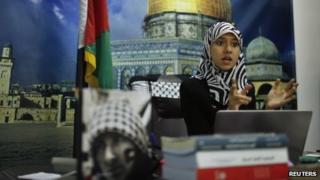 Isra al-Modallal in her office in Gaza (11 November 2013)