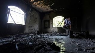 A Libyan man investigates the inside of the US Consulate after an attack that killed four Americans 13 September 2012