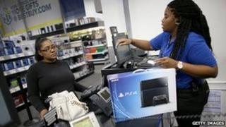 A customer buying PS4 console