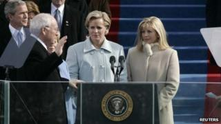 Liz Cheney (2nd R) with her sister Mary (2nd L) watches her father U.S. Vice president Dick Cheney (L) taking the oath for his second term in office from House Speaker Dennis Hastert (R) at inaugural ceremonies in Washington 20 January 2005