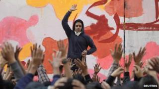 An anti-military protester leads chanting during a rally to commemorate the second anniversary of the deaths of 42 people in clashes with security forces on Mohamed Mahmoud Street, near Tahrir Square in Cairo November 19, 2013