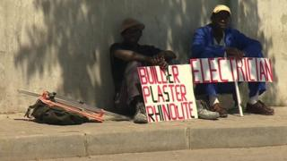 Job hunters with placards