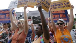 July 2013 file photo of opponents and supporters of an abortion bill outside the Texas Capitol, in Austin