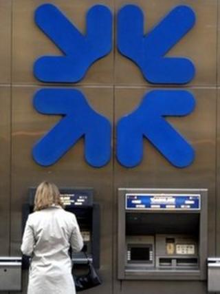 A woman using an RBS cash machine