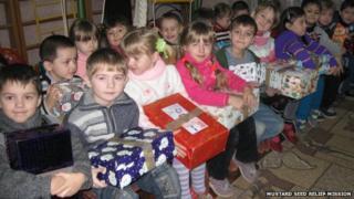 Children receiving presents in Ukraine