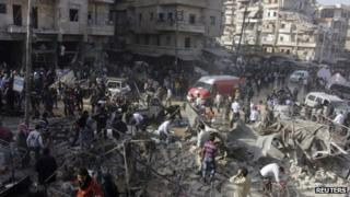 Aftermath of government airstrike on market in Syria's Aleppo, according to activists, 23 November 2013