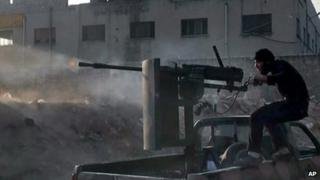 A Syrian rebel fires a weapon in Aleppo. File photo