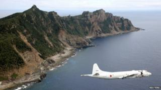 Japanese PC3 surveillance plane flies around the disputed islands in the East China Sea on 13 October 2011