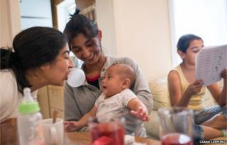 Zaneta (centre) and her younger sister Martina (left) entertain baby Roman – Zaneta's grandson
