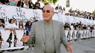 Arnon Milchan standing in front of a crowd