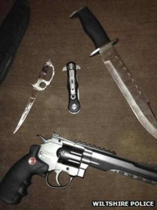 A replica gun and knives recovered from a property in Swindon